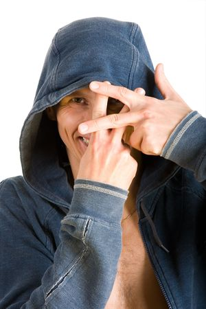 Smiling young man in a hoodie showing crossed fingers photo