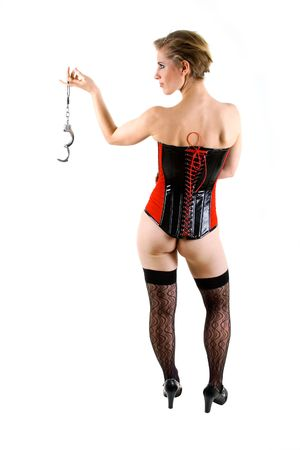 Young woman in corset with handcuffs in hand