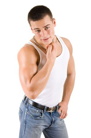 muscular build: Young athlete in white shirt and blue jeans Stock Photo