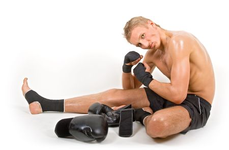Young man in boxing equipment showing his muscles photo