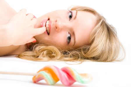 Young blond woman tempted by a lollipop Stock Photo - 2705247