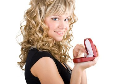 young friendly blond girl holding box with wedding ring photo