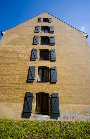 Side of a house with shape of arrow photo