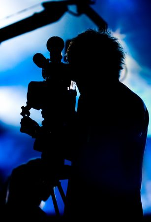 Silhouette of a cameraman filming fashion show catwalk