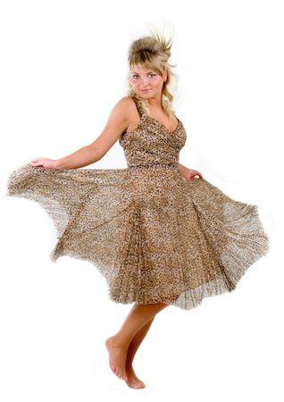 Dancing seductive young woman in leopard dress