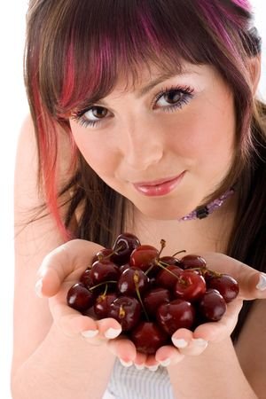 Portrait of seductive young woman holding fresh cherries in a hand photo