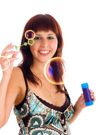 Young smiling brunette woman with soap bubbles photo