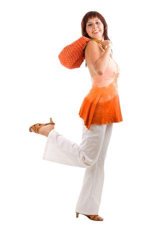 Running young shopaholic woman with orange bag photo