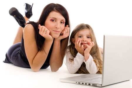 Young mother teaching her daughter how to use laptop and internet Stock Photo - 3264777