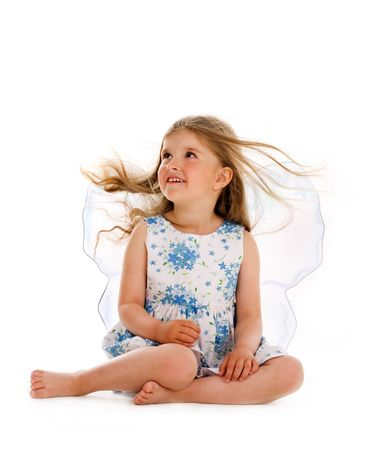 little girl barefoot: Isolated  girl with long hair untwisted and fairy wings Stock Photo