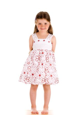 Little innocent girl on isolated background with hands behind her back