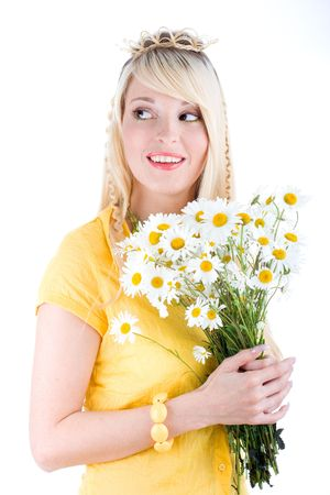 Cute girl with bunch of camomilles on isolated background photo