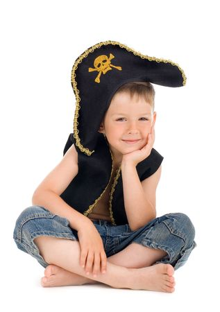 boy barefoot: Sitting little tired pirate on isolated background