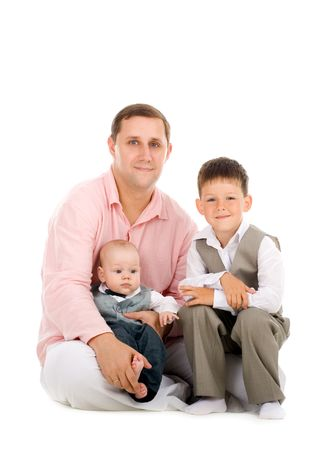 Father and two young sons sitting together Stock Photo - 3325593
