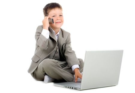 Little kid - businessman sitting with a laptop Stock Photo