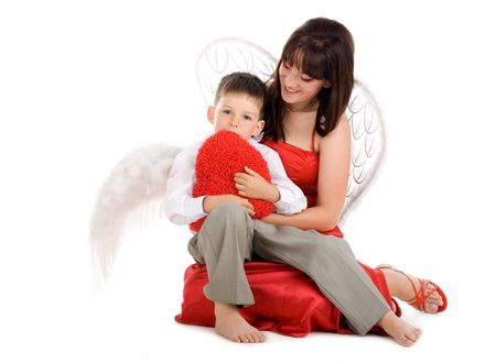 Angel mother with young angel child on isolated background photo