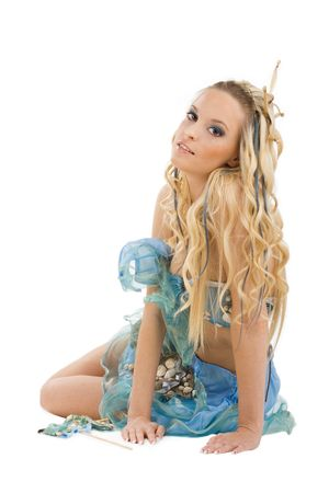 adult mermaid: Young beautiful girl in a blue designer dress