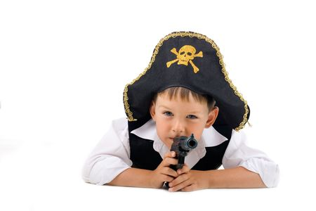Lying pirate boy on isolated white background
