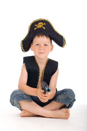 buccaneer: Sitting pirate boy on isolated white background