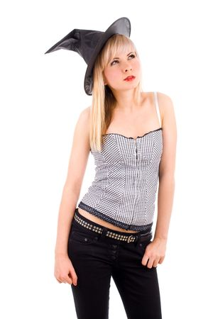 Young attractive witch woman in a black hat photo
