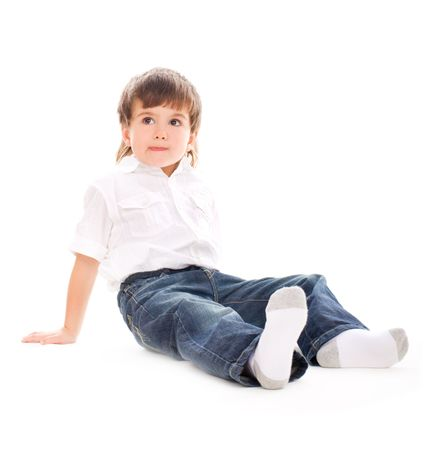 naughty boy: Young adorable boy sitting on isolated white