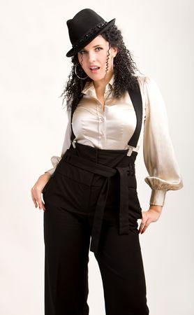 Dancing woman in hat and shirt with suspsenders photo