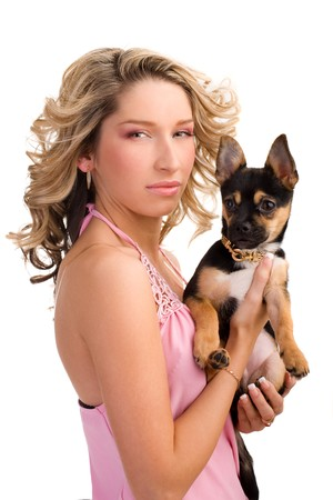bimbo: Young atrractive woman with a small dog on isolated white