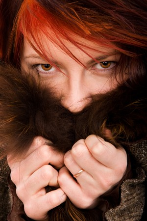 Woman and fur on isolated white background photo