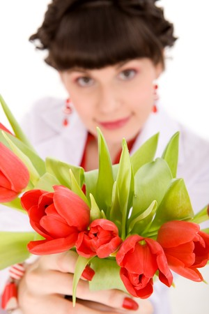 Girl with bouquet of tulips on isolated white photo