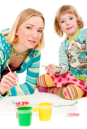Mother and daughter painting together on isolated white background photo