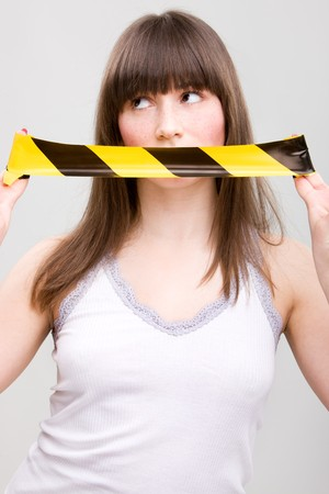 taped: Portrait of young woman with taped mouth Stock Photo