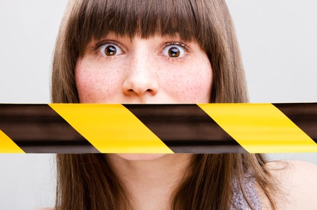 freckle: Portrait of young woman with taped mouth Stock Photo