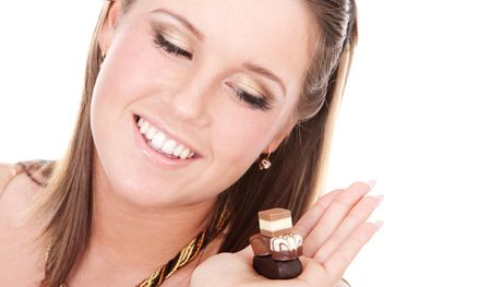 tempted: Portrait of young woman tempted by chocolate Stock Photo