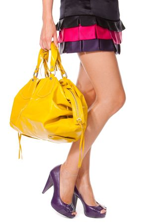 Beautiful woman legs with a yellow bag photo