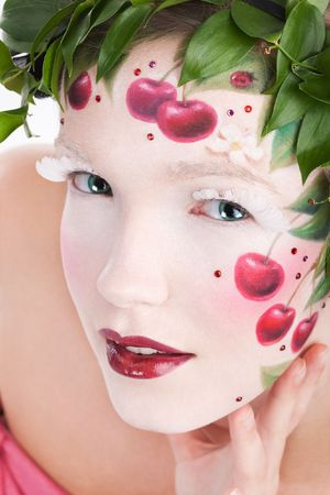 Closeup portrait of womans face with a fantasy cherry makeup photo