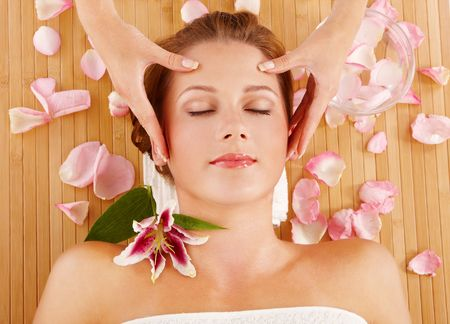 Portrait of young woman during massage in spa Stock Photo - 5615526