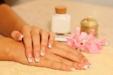 Hands of young woman with french manicure on the towel Stock Photo - 5816580