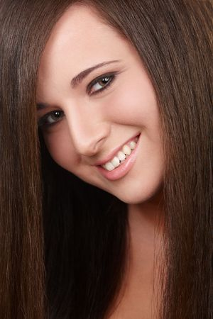 Portrait of young girl with beautiful straight hair photo