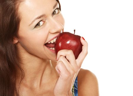 Face of young woman biting the red apple