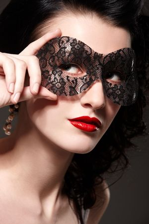 masked woman: Joven y bella mujer en m�scara de Carnaval Foto de archivo