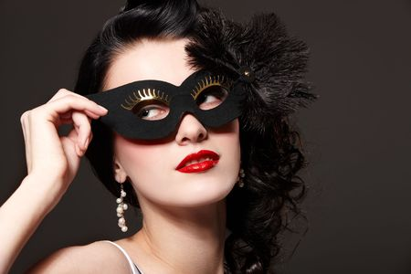 Beautiful young woman in carnival mask Stock Photo - 6408272