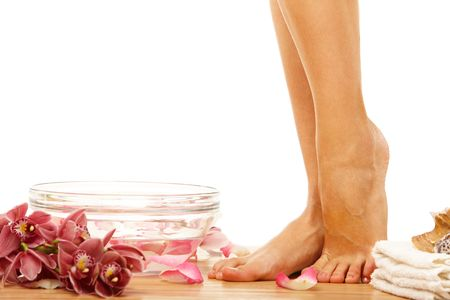 Foot of young woman om therapy event with flowers Stock Photo
