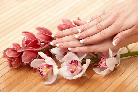 manicure: Spa hands over bamboo mat