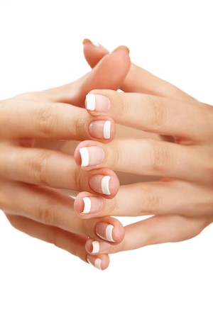 Young woman hands with natural (french) manicure over isolated white background