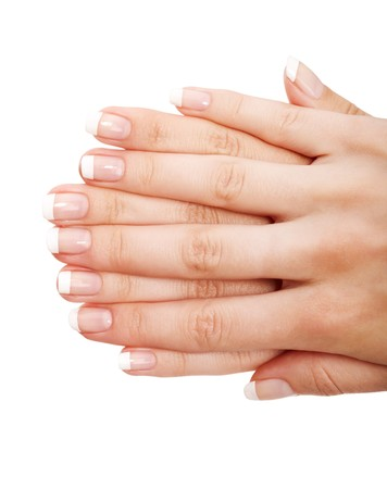 laque: Young woman hands with natural (french) manicure over isolated white background