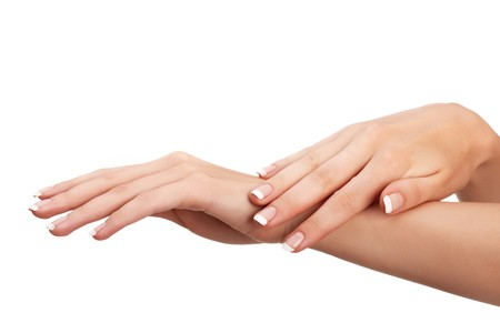 10 fingers: Young woman hands with natural french manicure over isolated white background