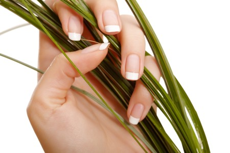 laque: Closeup image of hand and grass