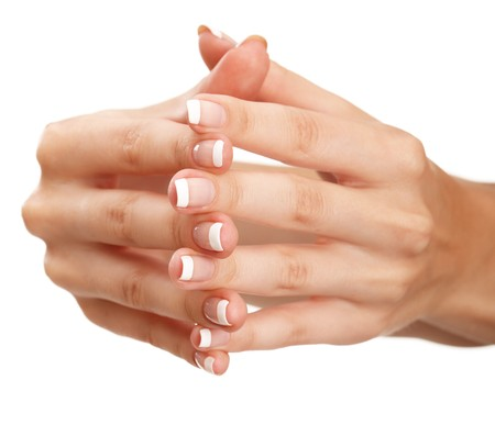 laque: Young woman hands with natural french manicure over isolated white background