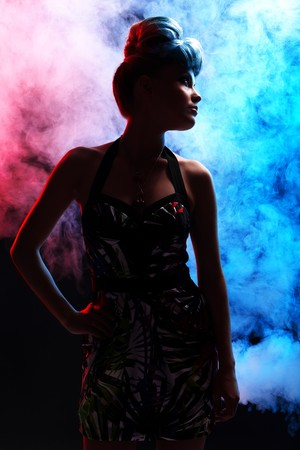 diabolic: Portrait of diabolic woman with red and blue lights in smoke Stock Photo