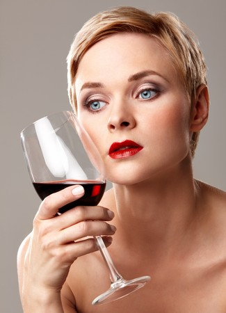 Closeup portrait of young woman holding glass of wine Stock Photo - 7940912